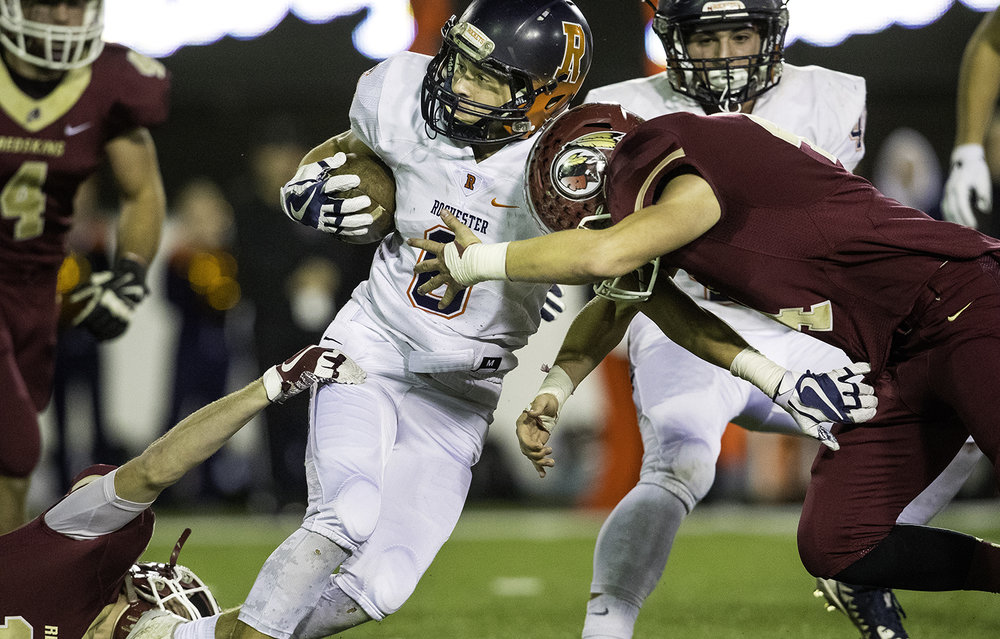 Rochester's Cade Eddington runs the ball against Morris during the IHSA Class 4A championship game at Huskie Stadium in Dekalb, Ill., Friday, Nov. 24, 2017. [Ted Schurter/The State Journal-Register]