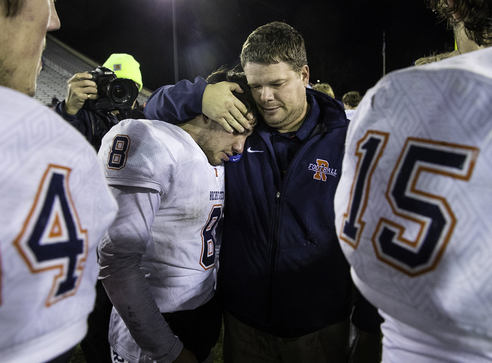 Rochester head coach Derek Leonard hugs Rocheste quarterback Nic Baker as the Rockets celebrate their championship in the IHSA Class 4A championship game at Huskie Stadium in Dekalb, Ill., Friday, Nov. 24, 2017. [Ted Schurter/The State Journal-Register]