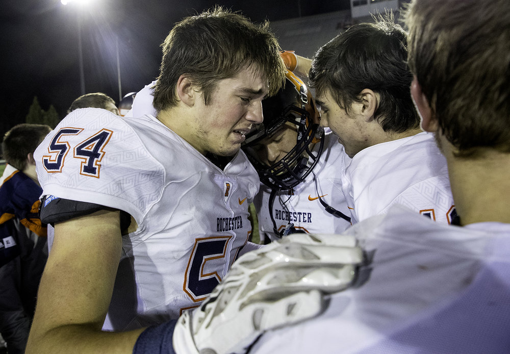 Rochester's Hunter Butcher celebrates with his teammates after the Rockets defeated Morris during the IHSA Class 4A championship game at Huskie Stadium in Dekalb, Ill., Friday, Nov. 24, 2017. [Ted Schurter/The State Journal-Register]