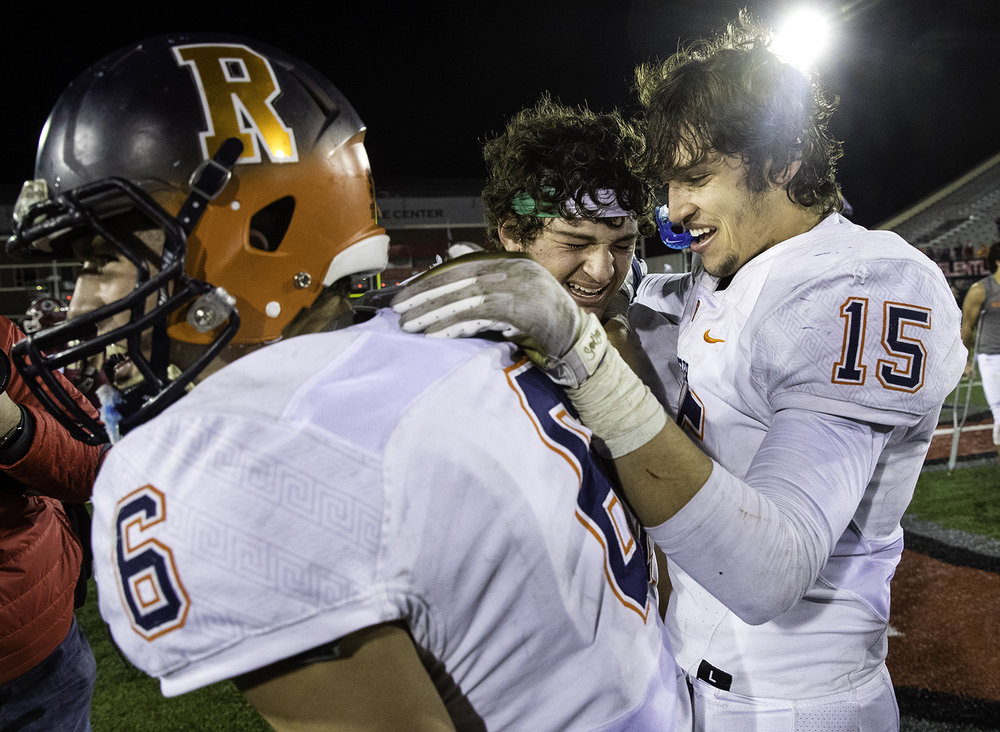 Rochester's Cade Eddington, Nick Capriotti and Stephan McCree celebrate after the Rockets beat Morris during the IHSA Class 4A championship game at Huskie Stadium in Dekalb, Ill., Friday, Nov. 24, 2017. [Ted Schurter/The State Journal-Register]