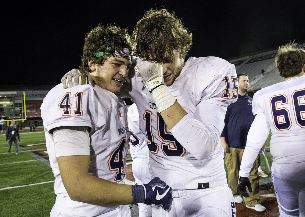 Rochester's Nick Capriotti and Stephan McCree celebrate after the Rockets defeated Morris during the IHSA Class 4A championship game at Huskie Stadium in Dekalb, Ill., Friday, Nov. 24, 2017. [Ted Schurter/The State Journal-Register]