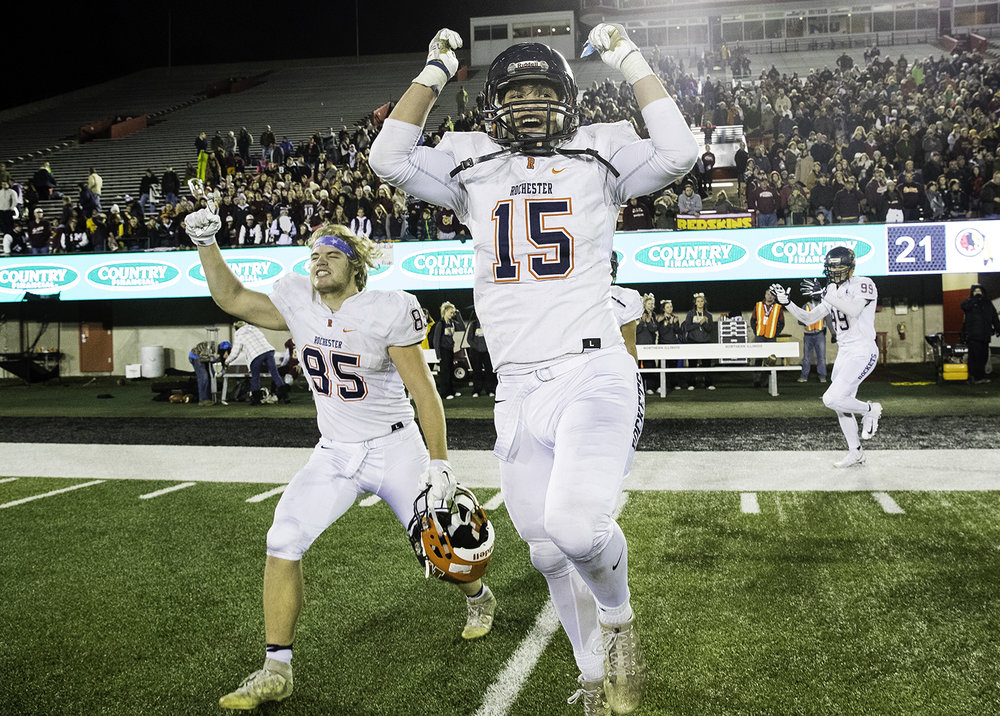 Rochester's Stephan McCree and Cole Allen celebrate after defeating Morris during the IHSA Class 4A championship game at Huskie Stadium in Dekalb, Ill., Friday, Nov. 24, 2017. [Ted Schurter/The State Journal-Register]