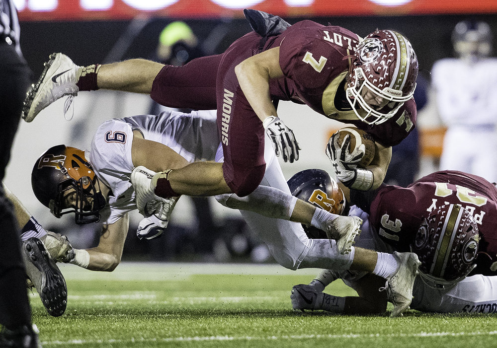 Rochester's Cade Eddington trips up Morris' Kameron Dransfeldt in the first half during the IHSA Class 4A championship game at Huskie Stadium in Dekalb, Ill., Friday, Nov. 24, 2017. [Ted Schurter/The State Journal-Register]