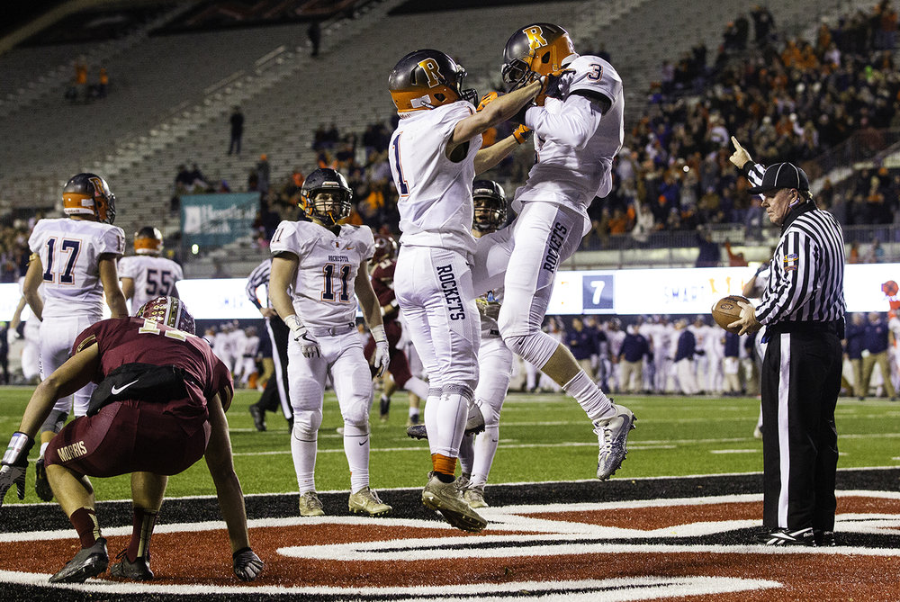 Rochester's Riley Lewis and David Allen celebrate Lewis' interception in the endzone in the first half during the IHSA Class 4A championship game at Huskie Stadium in Dekalb, Ill., Friday, Nov. 24, 2017. [Ted Schurter/The State Journal-Register]