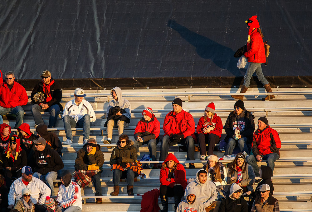 A Pleasant Plains fan finds their way to a seat prior to the Cardinals taking on Elmhurst IC Catholic in the IHSA Class 3A State Championship at Huskie Stadium, Friday, Nov. 24, 2017, in Dekalb, Ill. [Justin L. Fowler/The State Journal-Register]