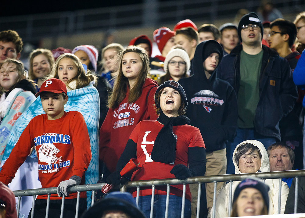 Pleasant Plains fans watch as the Cardinals trail Elmhurst IC Catholic 35-0 in the fourth quarter during the IHSA Class 3A State Championship at Huskie Stadium, Friday, Nov. 24, 2017, in Dekalb, Ill. [Justin L. Fowler/The State Journal-Register]