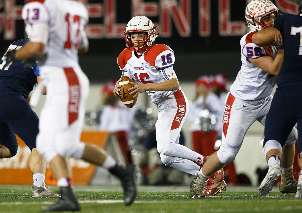 Pleasant Plains quarterback Ben Reinert (16) is chased out of the pocket against Elmhurst IC Catholic in the third quarter during the IHSA Class 3A State Championship at Huskie Stadium, Friday, Nov. 24, 2017, in Dekalb, Ill. [Justin L. Fowler/The State Journal-Register]