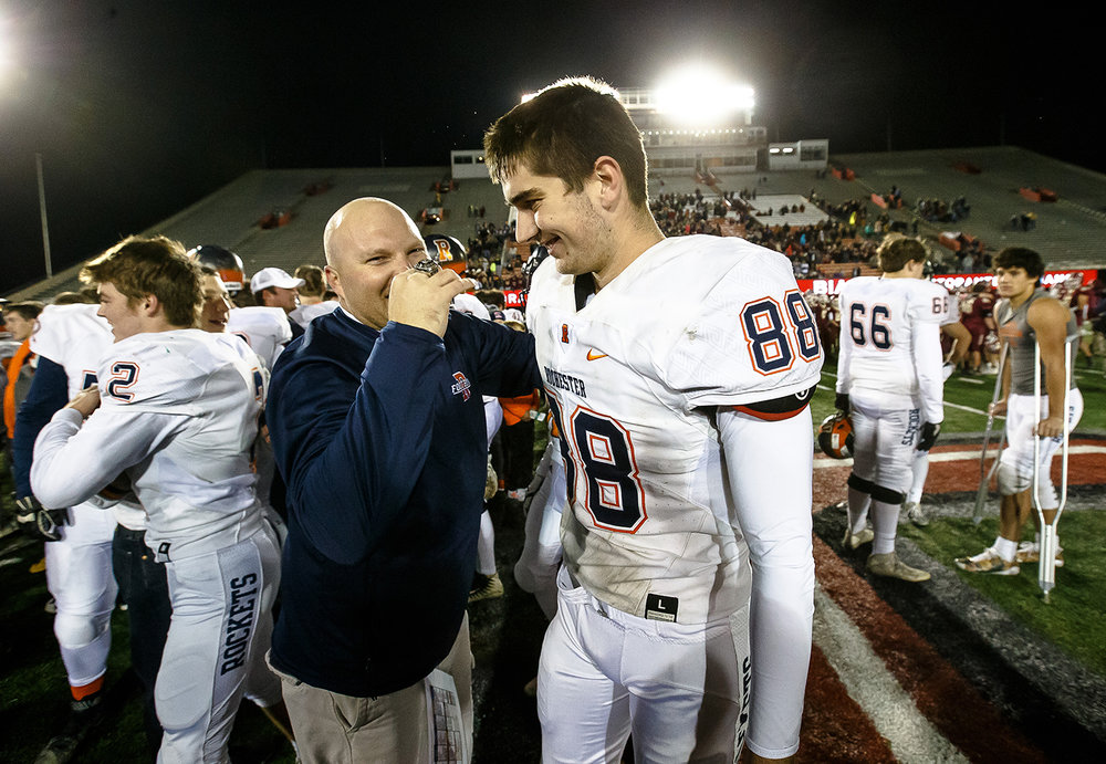Rochester's Clay Alewelt (88) is congratulated by defensive coordinator Steve Buecker after the Rockets defeated Morris 24-21 in the IHSA Class 4A State Championship at Huskie Stadium, Friday, Nov. 24, 2017, in Dekalb, Ill. [Justin L. Fowler/The State Journal-Register]