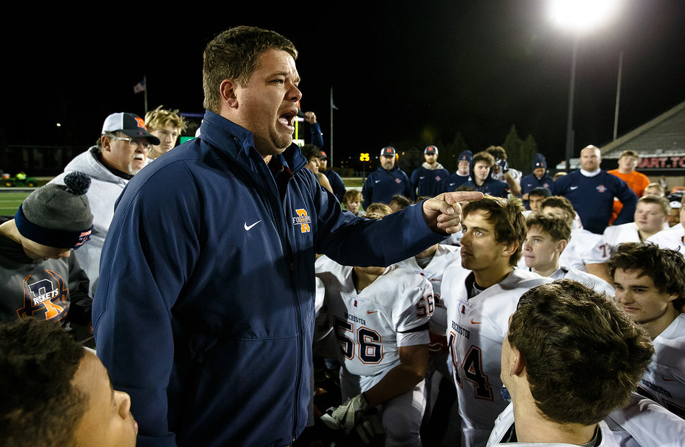 Rochester head football coach Derek Leonard becomes emotional as he talks about his mother as he talks to his players after the Rockets defeated Morris 24-21 in the IHSA Class 4A State Championship at Huskie Stadium, Friday, Nov. 24, 2017, in Dekalb, Ill. [Justin L. Fowler/The State Journal-Register]
