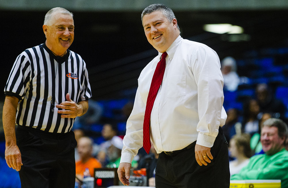 Springfield's Springfield head coach Joby Crum laughs with an official during the Capital City Showcase at the Bank of Springfield Center Saturday, Dec. 2, 2017. [Ted Schurter/The State Journal-Register]