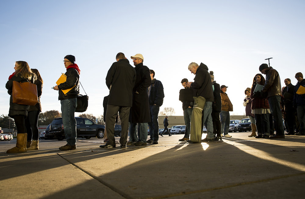 Candidates for state wide office or their representatives, lined up outside the Illinois State Board of Elections office Monday, Nov. 27, 2017. It is first day to file petitions to run in the March primary, which includes races for governor, lieutenant governor and attorney general, along with judges and county offices. [Rich Saal/The State Journal-Register]