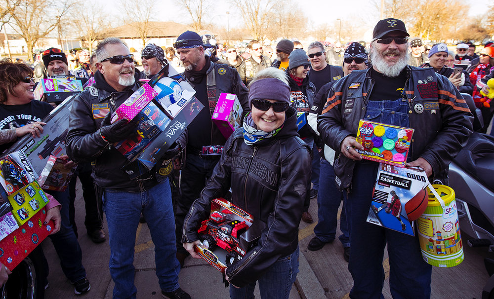 Participants in the 34th Sid Wood Memorial Toy Run line up outside the doors of Contact Ministries with their gift donations Sunday, Nov. 26, 2017. More than 113 bikes rode in the annual event that departs from Pipefitters Local 137, 2880 E. Cook St. and proceeds to Contact Ministries. [Ted Schurter/The State Journal-Register]