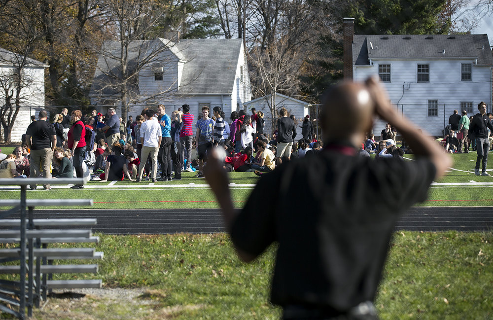 A man tries to pick out his son from among the Springfield High School students who were evacuated to the athletic field Tuesday, Nov. 28 after a bomb threat was called in to the school. [Rich Saal/The State Journal-Register]