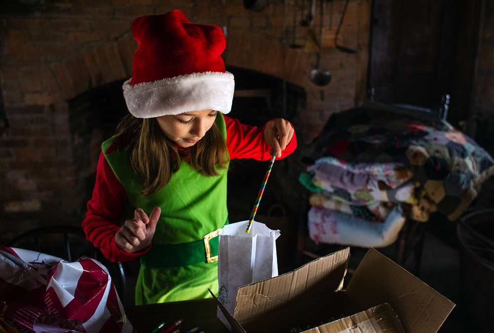 Adelyn Rollins fills gift bags for guests during the Historic Clayville Christmas event Saturday, Dec. 2, 2017. The event featured face painting, crafts, a holiday store and a chance to be photographed with Santa. [Ted Schurter/The State Journal-Register]
