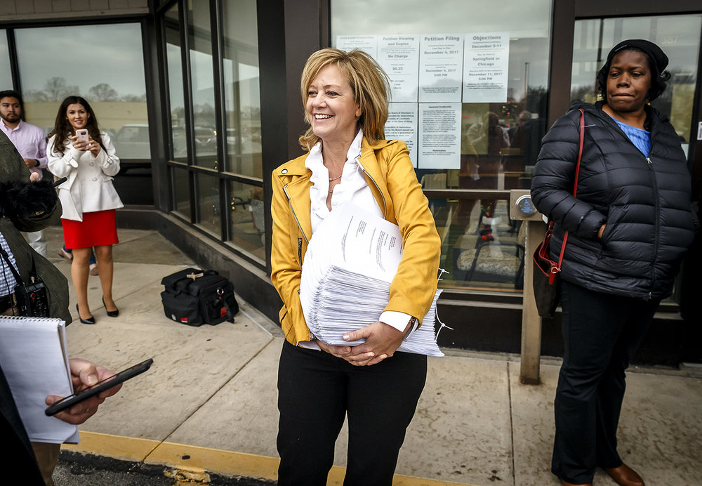 Illinois State Rep. Jeanne Ives, R-Wheaton, holds her signatures as she prepares to file to run in the Republican primary for Illinois governor at the Illinois State Board of Elections, Monday, Dec. 4, 2017, in Springfield, Ill. [Justin L. Fowler/The State Journal-Register]