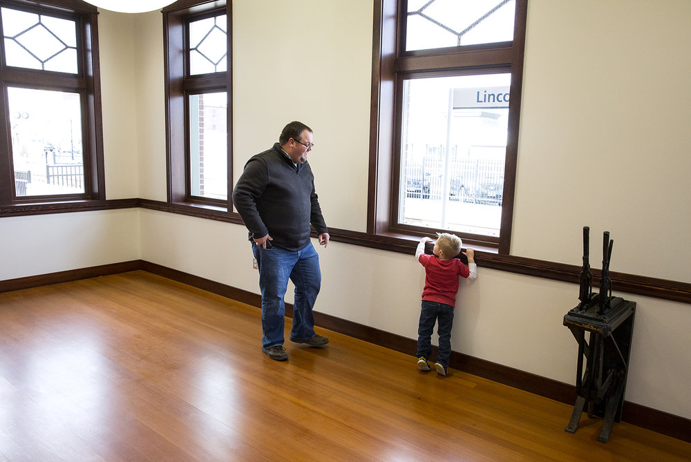 Justin Sobeck and his son, Jackson, 4, explore the renovated Amtrak railroad station Tuesday, Dec. 5, 2017, in Lincoln, Ill., following a $4.04 million project to restore the historic character of the building built in 1911, and not used as a passenger depot for more than 30 years. [Rich Saal/The State Journal-Register]