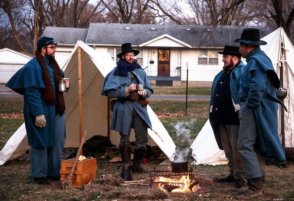"Alex Dixon, left, James Beaver, of Peoria, Ill., Chris Jebb, of Avon, Ill., and Tom Travis, of Bradley, Ill., right, recreate what the winter quarters would have looked like in 1862 during the Civil War prior to the Battle of Stone River near Murfreesboro, Tenn., during the ""Christmas at the Front"" at the Illinois State Military Museum, Saturday, Dec. 9, 2017, in Springfield, Ill. Military Museum living historians recreated scenes and told the stories of how soldiers celebrated Christmas during the Revolutionary War, Civil War, World War I and World War II. [Justin L. Fowler/The State Journal-Register]"