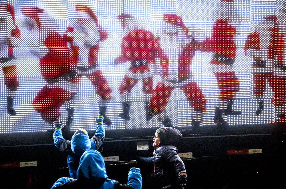 Children jump in with a group of dancing Santas on a digital sign from the Ace Sign Company float during the 2017 Springfield Jaycees Christmas Parade, Saturday, Dec. 9, 2017, in Springfield, Ill. [Justin L. Fowler/The State Journal-Register]