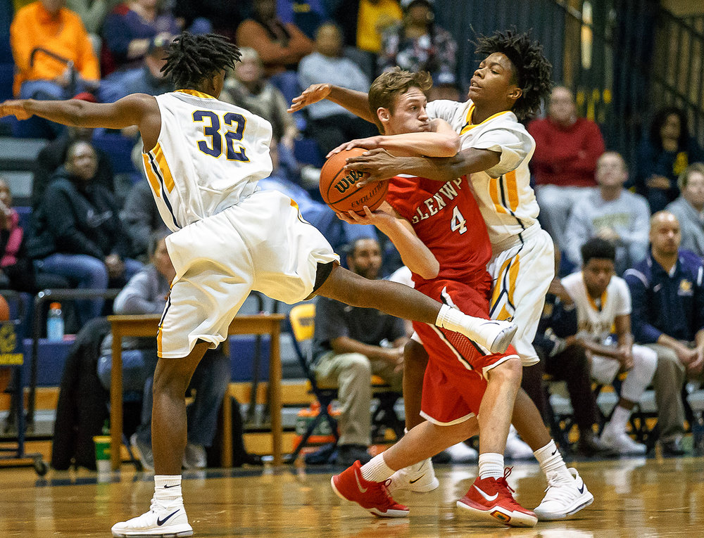 Glenwood's Matt Bahlmann (4) is smothered by Southeast's Terrion Murdix (4) as he tries to find an opening for a pass in the first half at Herb Scheffler Gymnasium, Friday, Dec. 15, 2017, in Springfield, Ill. [Justin L. Fowler/The State Journal-Register]