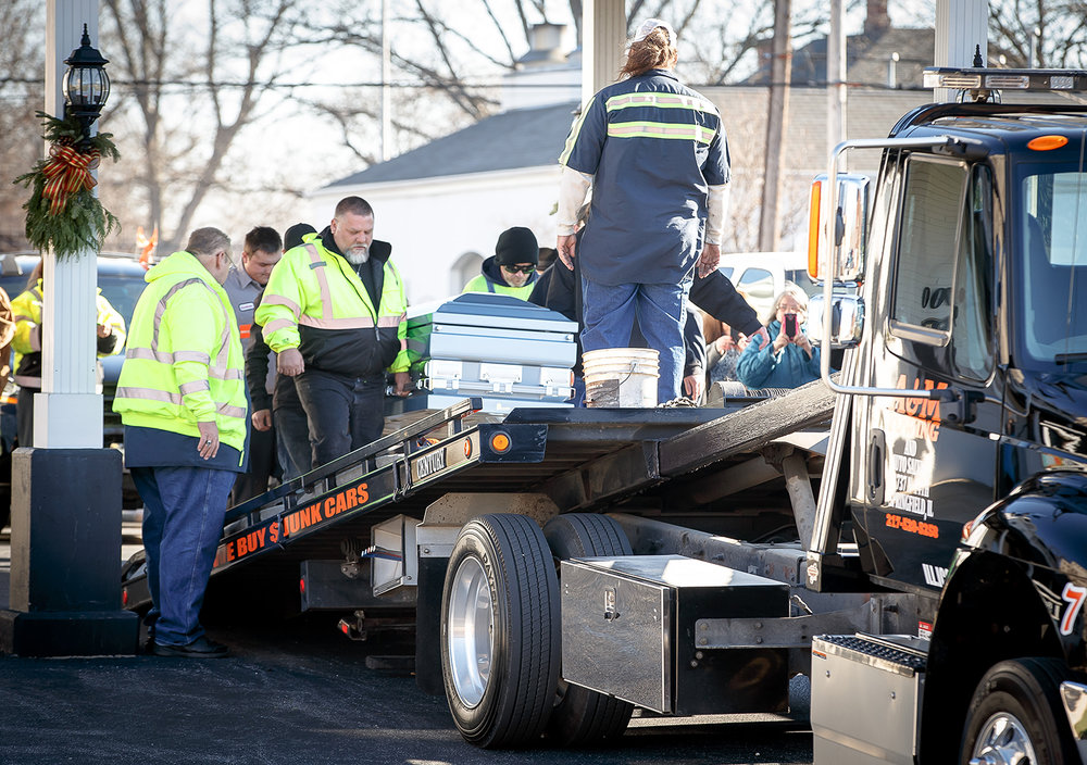 Pallbearers carry the casket of Ron Chaney up the flatbed of a tow-truck from A&M Towing and Salvage as they prepare for procession of tow trucks during the funeral for the tow-truck driver at Kirlin-Egan & Butler Funeral Home, Saturday, Dec. 16, 2017, in Springfield, Ill. Chaney died from injuries he received after he was struck by another vehicle while working to load a disabled vehicle onto his truck on I-72 between the MacArthur Boulevard and Veterans Parkway exits. [Justin L. Fowler/The State Journal-Register]