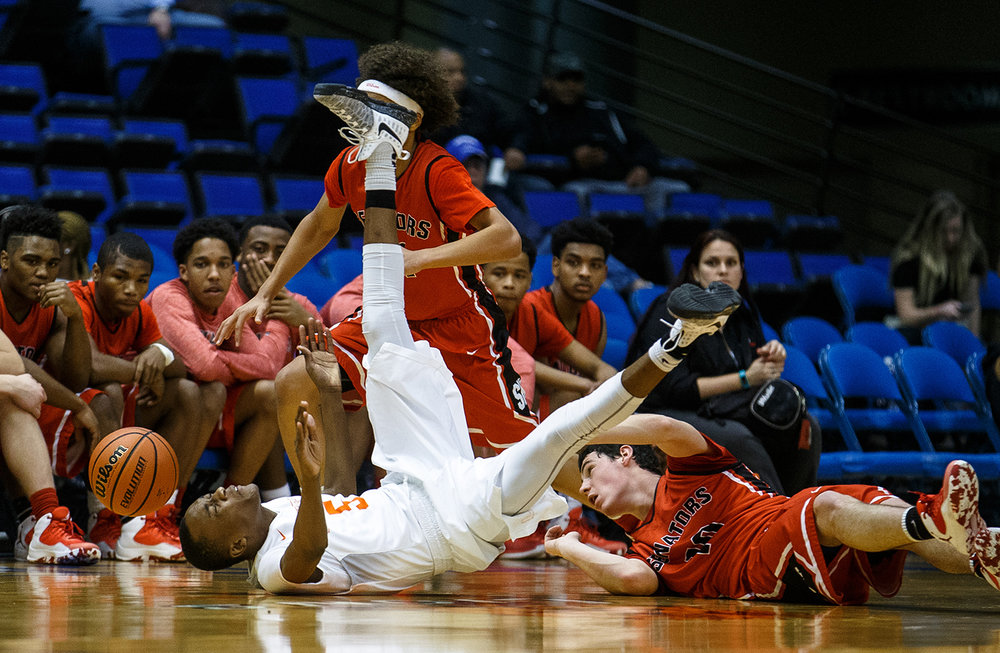 Lanphier's James Jones (5) hits the deck going for a loose ball against Springfield's Trevor Minder (10) in the third quarter of the Boys City Basketball Tournament at the Prairie Capital Convention Center, Thursday, Jan. 19. Justin L. Fowler/The State Journal-Register