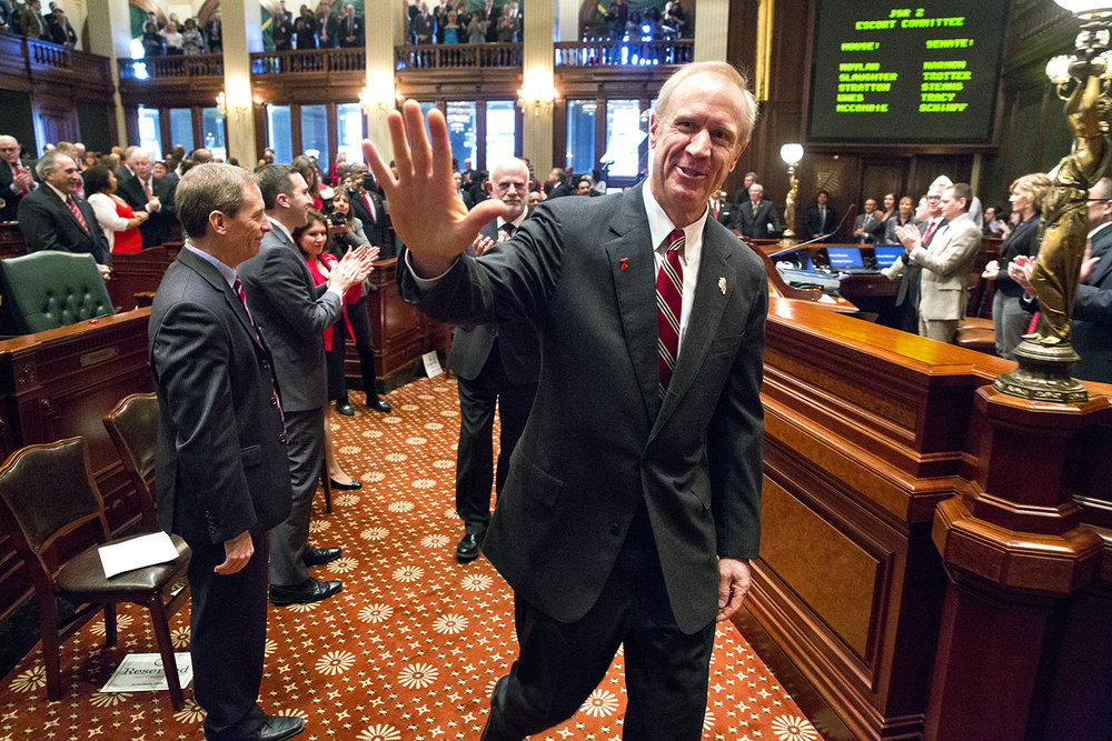 Gov. Bruce Rauner acknowledges Republican lawmakers as he approaches the dais to deliver his Budget Address to a joint session of the General Assembly at the Capitol Feb. 15. Rich Saal/The State Journal-Register