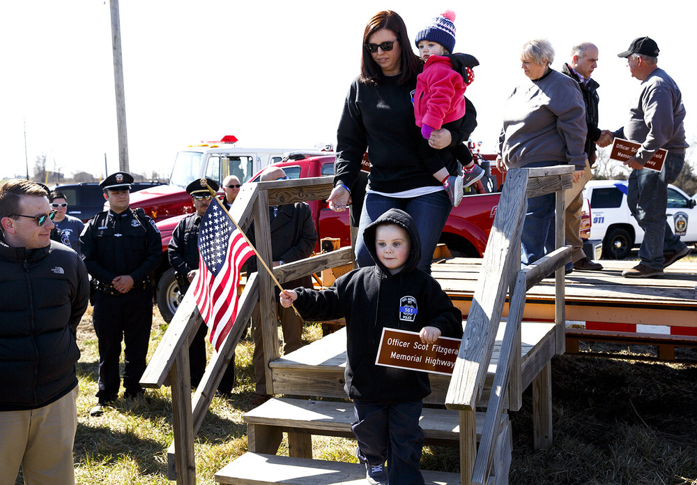 Dani Fitzgerald, widow of Officer Scot Fitzgerald, with her daughter Fynlee, 1 and son, Colton, 5, step down from a platform following a ceremony renaming a portion of Illinois 267 in Morgan County after her late husband March 3. Scot Fitzgerald was a police officer with the village of South Jacksonville and a Morgan County sheriff's deputy when he was killed in an automobile accident in 2016 while responding to a call on the highway. Rich Saal/The State Journal-Register