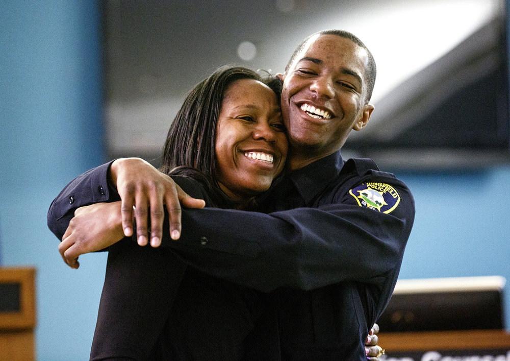 It was a joyful moment for Springfield Police Officer Lamar Moore who hugged his mother Michelle Epps after she pinned his badge on him during the swearing in of seven new Springfield police officers April 4  in the city council chambers. Rich Saal/The State Journal-Register