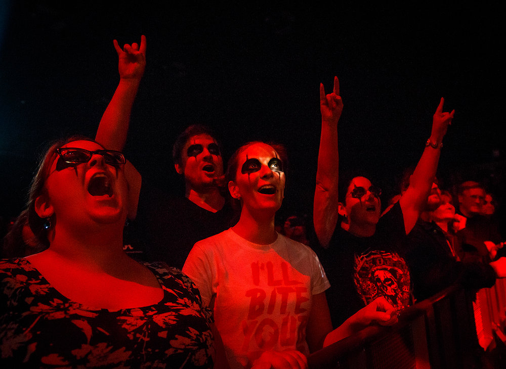 Stages lights catch the eye of Kristin Barnett as she sings along with her sister Lisa Miller, left, husband Cainan Barnett and her mother Susan Miller, right, at the Alice Cooper concert April 23 at the Prairie Capital Convention Center. Justin L. Fowler/The State Journal-Register