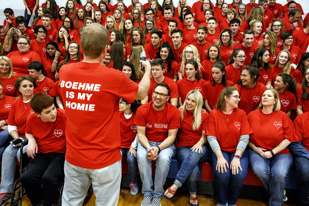 Red T-shirts meant a show of support for Pleasant Plains High School art teacher Jim Boehme, center, first row, who was celebrating the anniversary of a heart transplant that saved his life10 years ago. At the school on May 5, principal Luke Brooks organized everyone for a group picture. Rich Saal/The State Journal-Register
