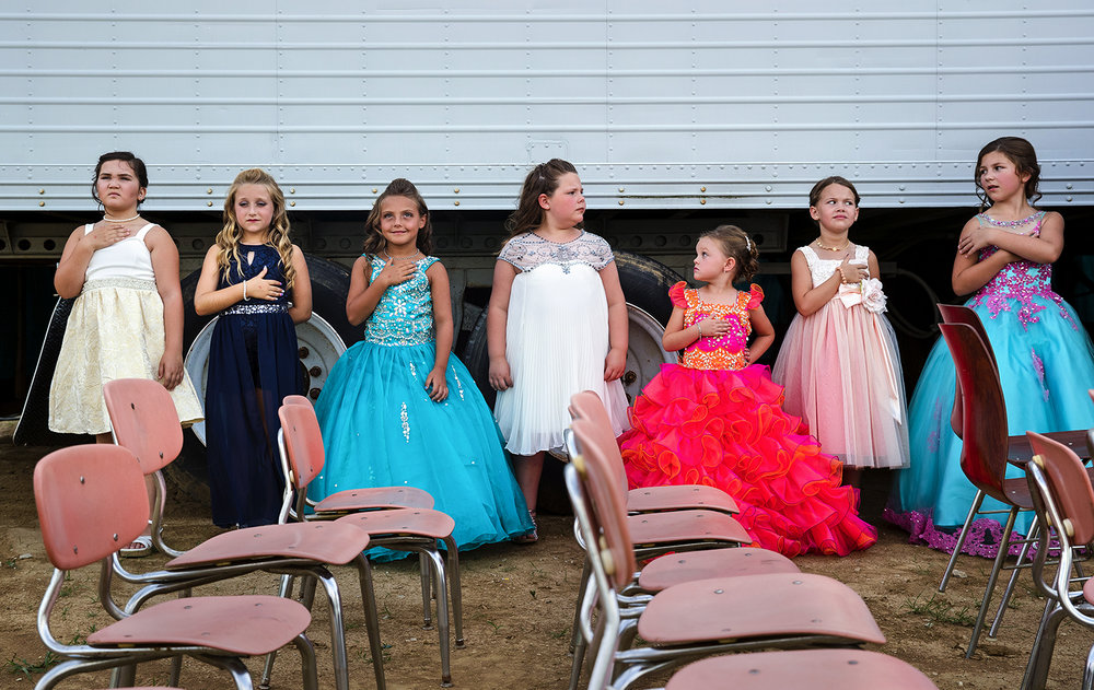 Little Miss candidates line up backstage and listen to the National Anthem during the Queen Pageant at the 32nd Annual Montgomery County Fair in Butler June 21. Ted Schurter/The State Journal-Register