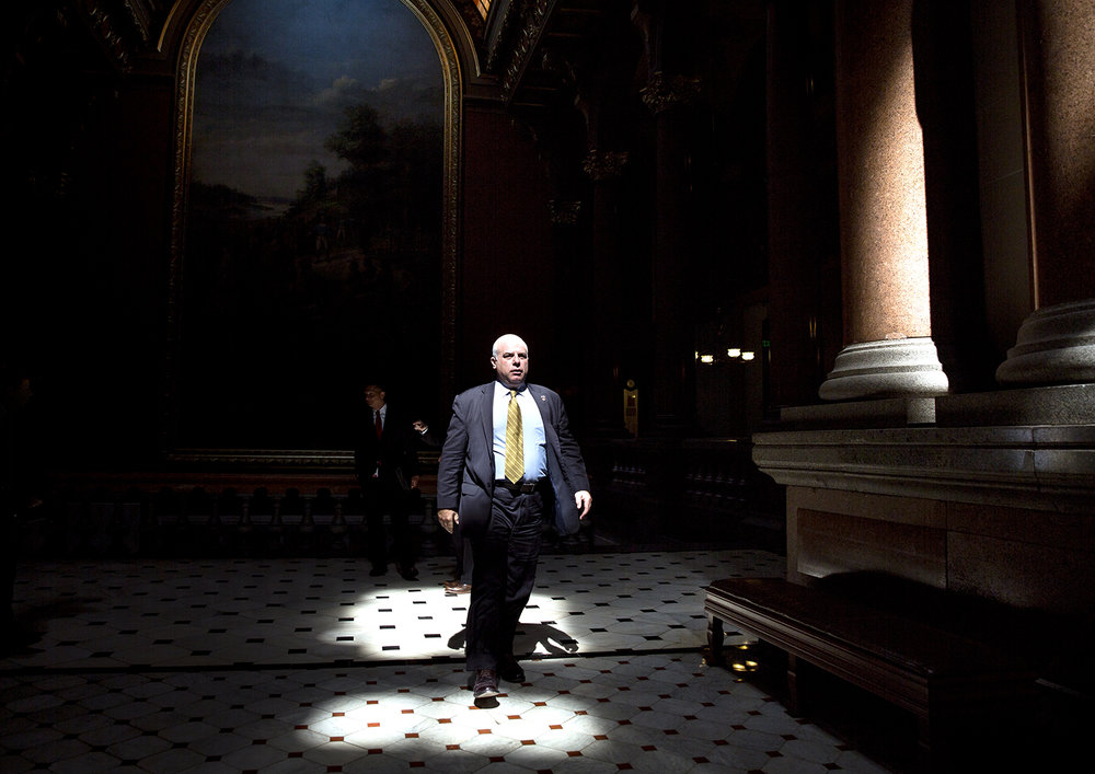 Sen. Sam McCann, R-Plainview, walks to the Senate chamber at the Capitol on July 4 for the start of a special session to reach a budget deal. Rich Saal/The State Journal-Register