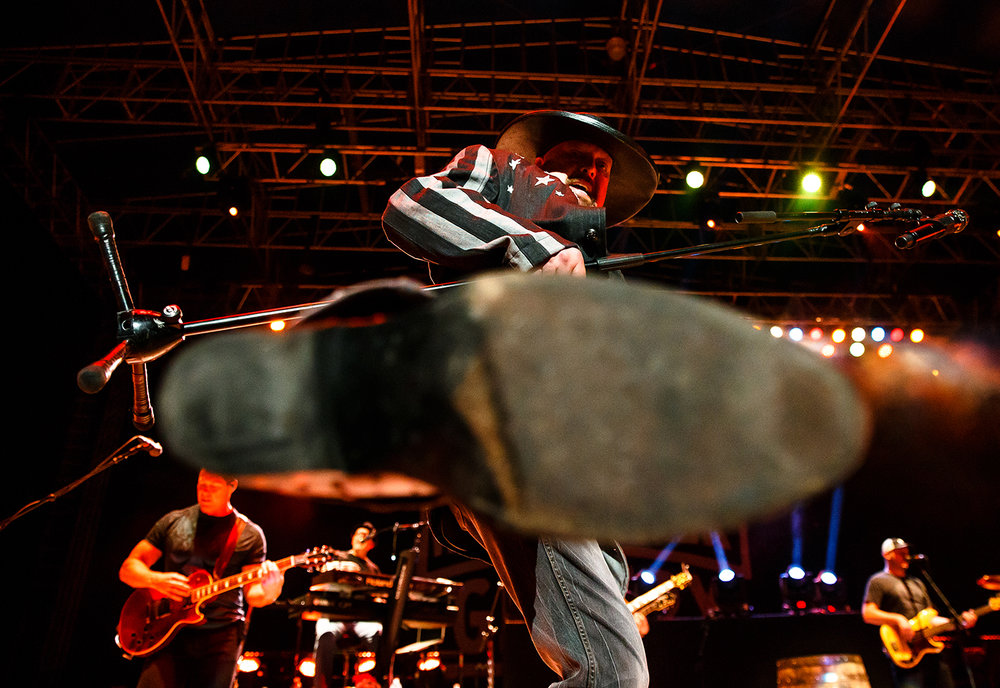 Eddie Montgomery of Montgomery Gentry kicks his foot toward a photographer while performing on the Grandstand Stage during the Illinois State Fair Aug. 18. Justin L. Fowler/The State Journal-Register