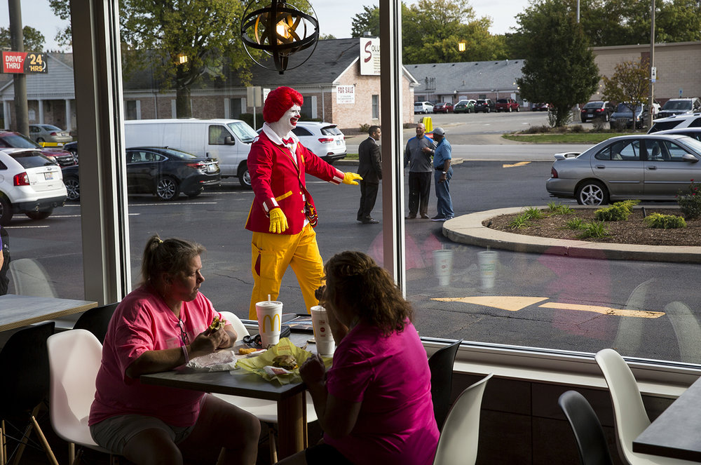The Ronald McDonald character greets cars pulling into the restaurant at Sixth Street and South Grand Avenue Oct. 10, following a ribbon cutting ceremony re-opening the remodeled store. Rich Saal/The State Journal-Register