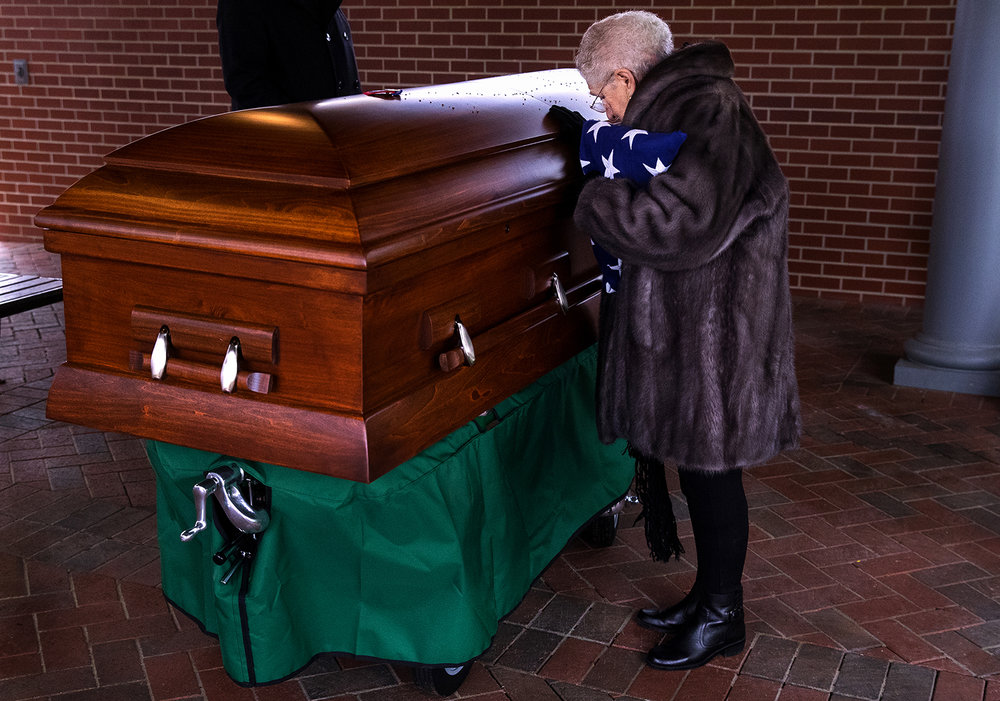 Rose Aiello Palazzolo pauses at the casket of her uncle, Army Staff Sgt. Michael Aiello, before leaving the burial service at Camp Butler National Cemetery Oct. 28. Military records indicated Aiello went missing Sept. 30, 1944 during intense fighting near the bridge at Nijmegen in the Netherlands. About eight years ago, the military disinterred a set of remains that were later identified as Aiello. Ted Schurter/The State Journal-Register