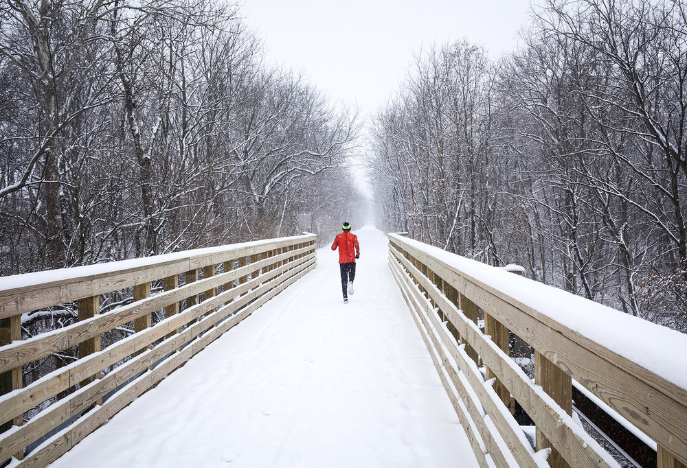 Three inches of snow on Christmas eve came just in time for those wanting a white Christmas. It also provided a beautiful scene along the Sangamon Valley Trail Dec. 24, where a runner made his way through the winter wonderland. Rich Saal/The State Journal-Register