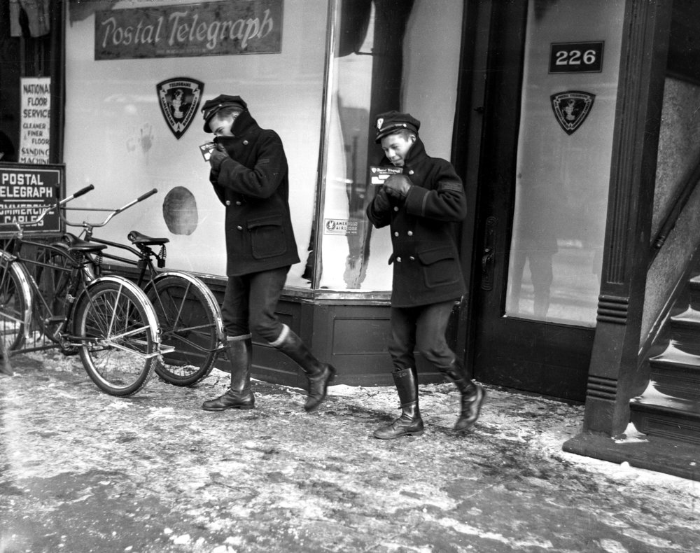 Postal telegraph carriers, exact date unknown, in envelope with other images from Jan. 1937. File/The State Journal-Registertelegraph; communications; bicycle; postal