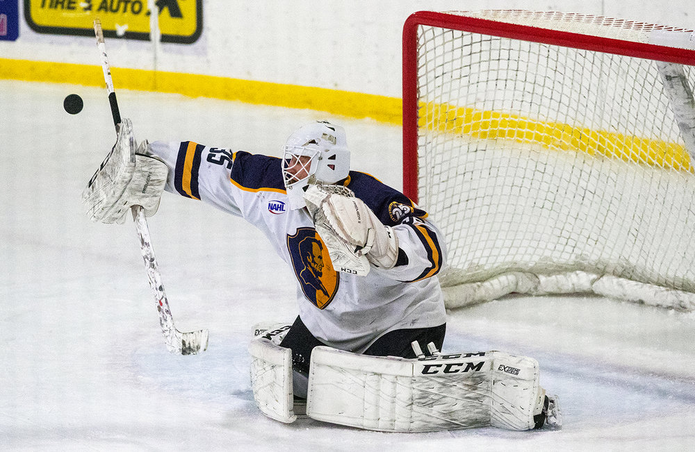 Springfield Jr. Blues goalie Evan Fear deflects a shot on goal from Janesville at the Nelson Center Friday, Jan. 5, 2018. The Jets defeated the Jr. Blues 2-0. [Ted Schurter/The State Journal-Register]