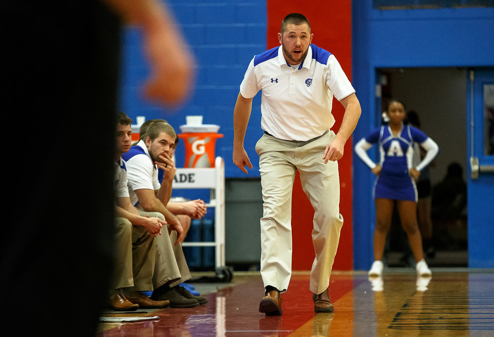 Auburn boys basketball head coach Seth McCoy watches as his team takes on Athens in the first half during opening night of the Boys Sangamon County Tournament at Lincoln Land Community College's Cass Gymnasium, Monday, Jan. 8, 2018, in Springfield, Ill. [Justin L. Fowler/The State Journal-Register]