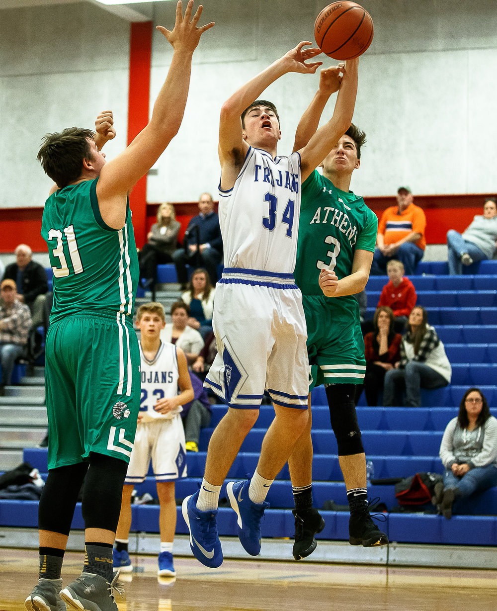 Auburn's Connor Tripp (34) has his shot blocked by Athens' Jack Richards (3) in the first half during opening night of the Boys Sangamon County Tournament at Lincoln Land Community College's Cass Gymnasium, Monday, Jan. 8, 2018, in Springfield, Ill. [Justin L. Fowler/The State Journal-Register]