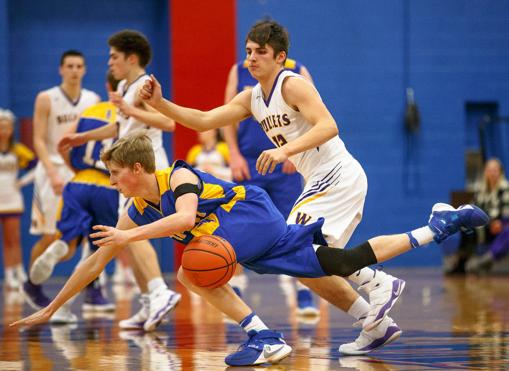 Buffalo Tri-City's Gage Krider (23) hits the floor and looses control of the ball against Williamsville's Keegan McGann (12) in the first half during opening night of the Boys Sangamon County Tournament at Lincoln Land Community College's Cass Gymnasium, Monday, Jan. 8, 2018, in Springfield, Ill. [Justin L. Fowler/The State Journal-Register]