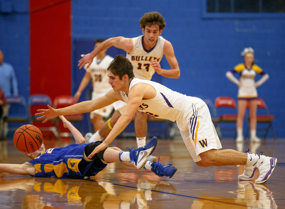 Williamsville's Keegan McGann (12) leaps out to try and gain possession of the ball against Buffalo Tri-City in the first half during opening night of the Boys Sangamon County Tournament at Lincoln Land Community College's Cass Gymnasium, Monday, Jan. 8, 2018, in Springfield, Ill. [Justin L. Fowler/The State Journal-Register]
