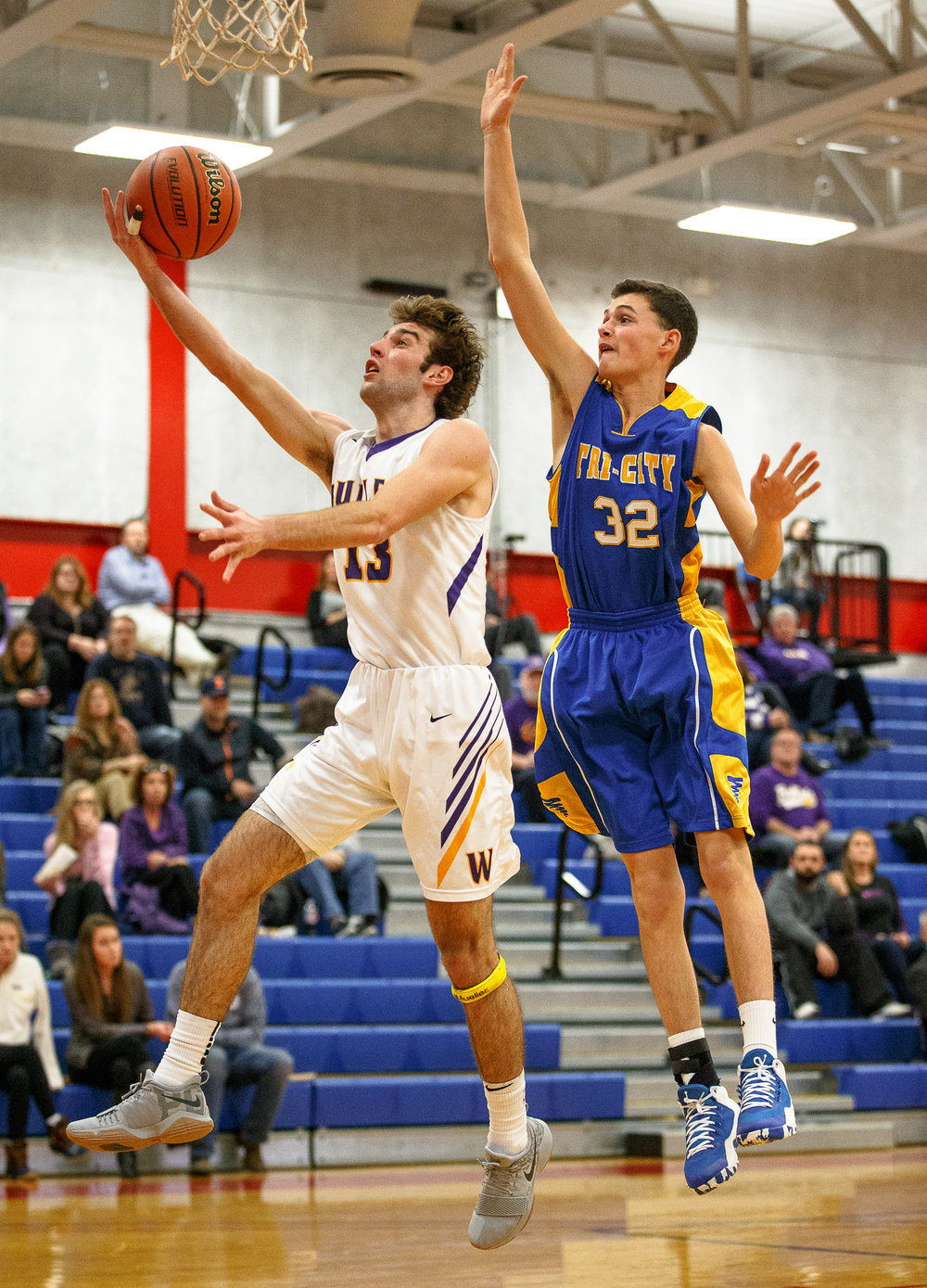 Williamsville's Joseph Mitchell (13) goes up for a shot against Buffalo Tri-City's Jace Tarr (32) in the second half during opening night of the Boys Sangamon County Tournament at Lincoln Land Community College's Cass Gymnasium, Monday, Jan. 8, 2018, in Springfield, Ill. [Justin L. Fowler/The State Journal-Register]