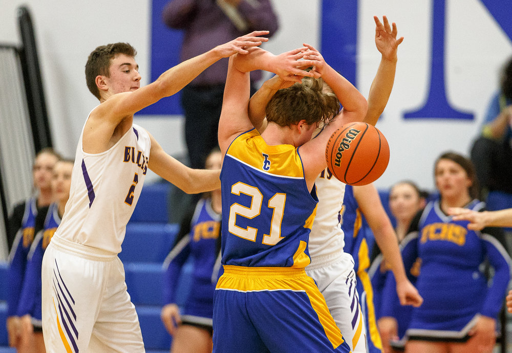 Buffalo Tri-City's Logan Dilley (21) has the ball knocked out of his hands by Williamsville's Casey Tuttle (2) in the second half during opening night of the Boys Sangamon County Tournament at Lincoln Land Community College's Cass Gymnasium, Monday, Jan. 8, 2018, in Springfield, Ill. [Justin L. Fowler/The State Journal-Register]