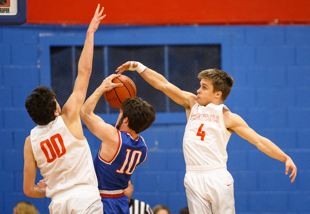 New Berlin's Carson Reese (4) tries to block a shot from Pawnee's Ethan Clarke (10) in the first half during the second night of the Boys Sangamon County Tournament at Lincoln Land Community College's Cass Gymnasium, Tuesday, Jan. 9, 2018, in Springfield, Ill. [Justin L. Fowler/The State Journal-Register]