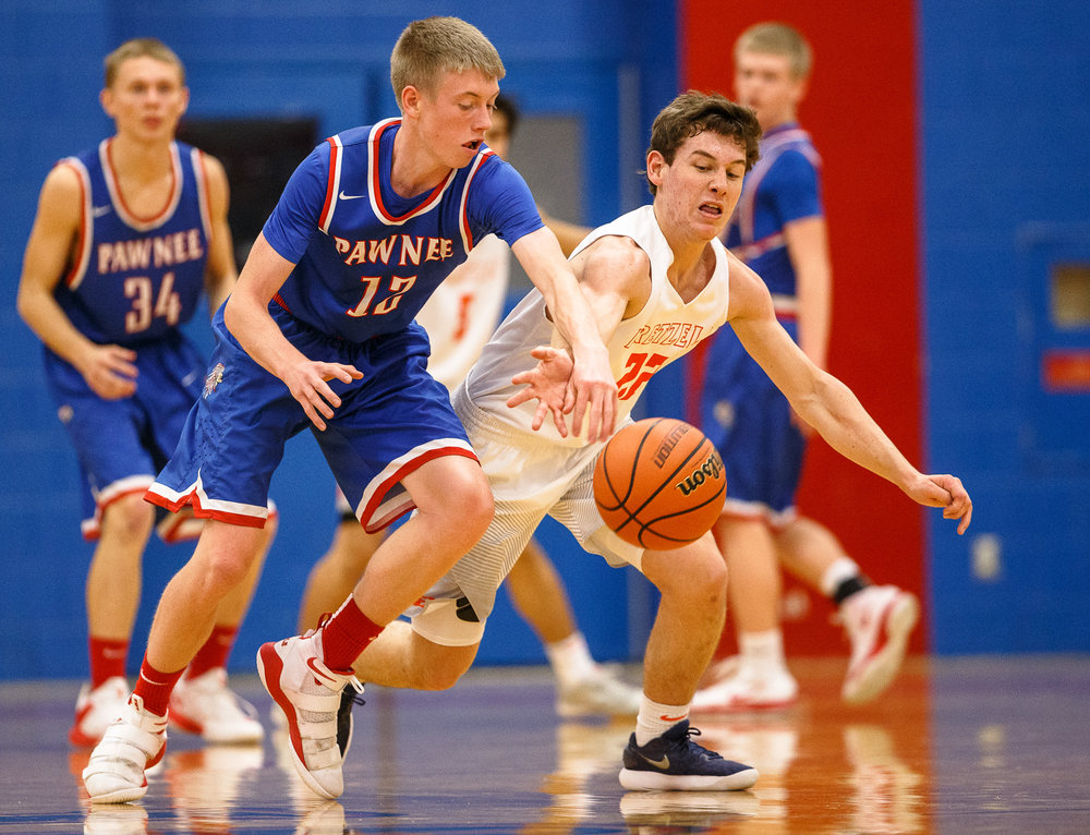 New Berlin's Connor Allen (22) steals the ball away from Pawnee's Brady Jarrett (12) in the first half during the second night of the Boys Sangamon County Tournament at Lincoln Land Community College's Cass Gymnasium, Tuesday, Jan. 9, 2018, in Springfield, Ill. [Justin L. Fowler/The State Journal-Register]