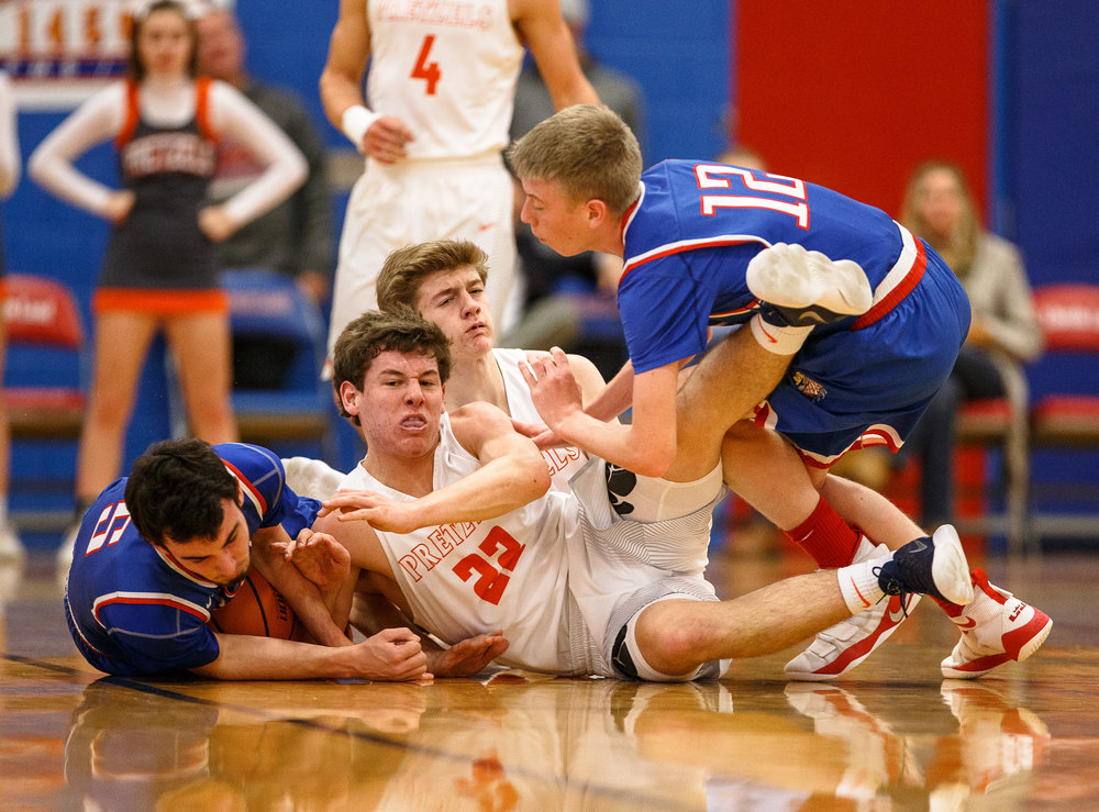 New Berlin's Connor Allen (22) hits the floor going after a ball against Pawnee's Hendy Hamilton (5) in the first half during the second night of the Boys Sangamon County Tournament at Lincoln Land Community College's Cass Gymnasium, Tuesday, Jan. 9, 2018, in Springfield, Ill. [Justin L. Fowler/The State Journal-Register]
