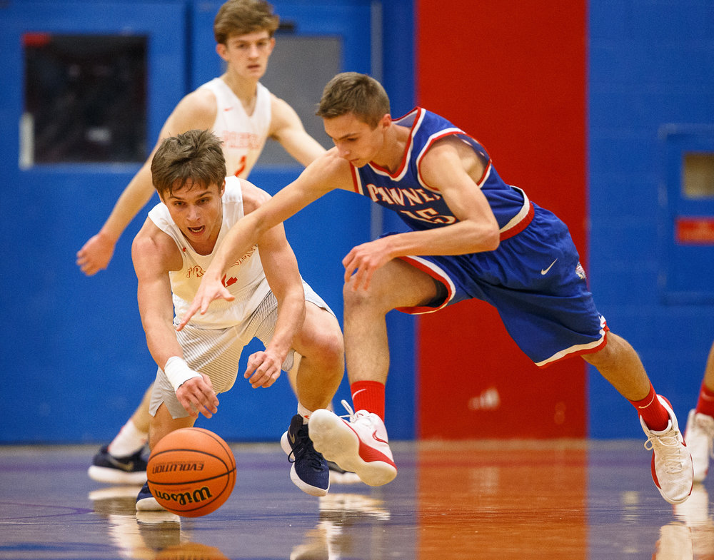 New Berlin's Carson Reese (4) dives for a ball he knocked away from Pawnee in the first half during the second night of the Boys Sangamon County Tournament at Lincoln Land Community College's Cass Gymnasium, Tuesday, Jan. 9, 2018, in Springfield, Ill. [Justin L. Fowler/The State Journal-Register]