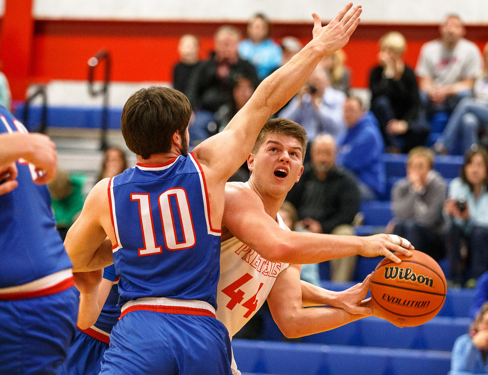 New Berlin's Casey Bixby (44) goes up for a shot against Pawnee's Ethan Clarke (10) in the first half during the second night of the Boys Sangamon County Tournament at Lincoln Land Community College's Cass Gymnasium, Tuesday, Jan. 9, 2018, in Springfield, Ill. [Justin L. Fowler/The State Journal-Register]