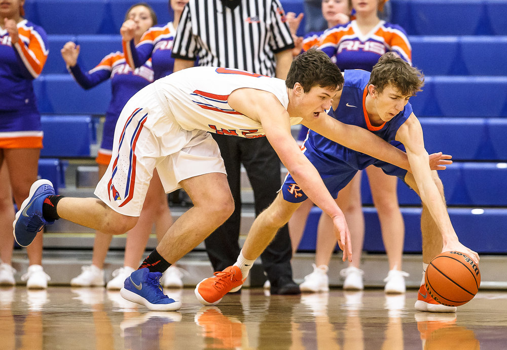 Pleasant Plains' Joel Niermann (30) dives for the ball against Riverton's Spencer Yoggerst (42) in the first half during the second night of the Boys Sangamon County Tournament at Lincoln Land Community College's Cass Gymnasium, Tuesday, Jan. 9, 2018, in Springfield, Ill. [Justin L. Fowler/The State Journal-Register]
